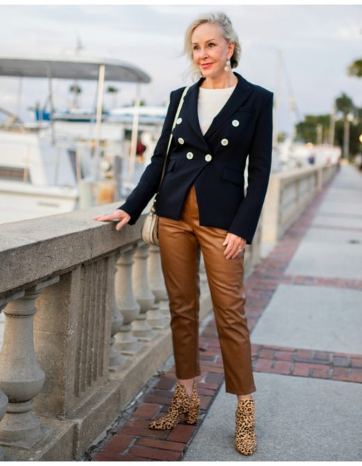 Sheree of the SheSheShow walking by marina wearing brown leather pants and navy double breasted blazer