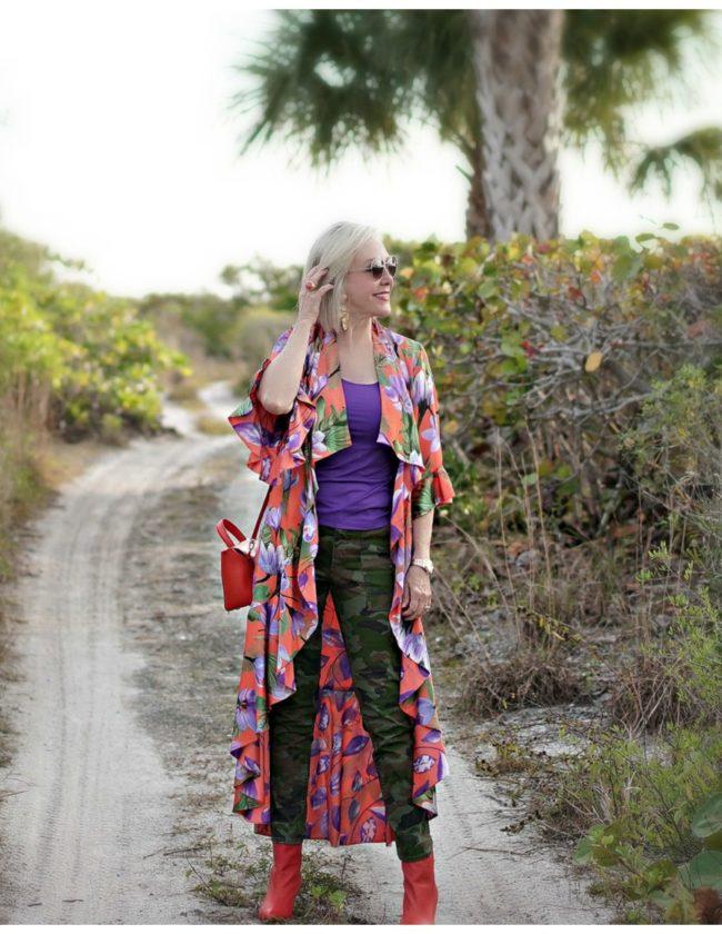 Sheree in alice + olivia kimono walking down a tropical path