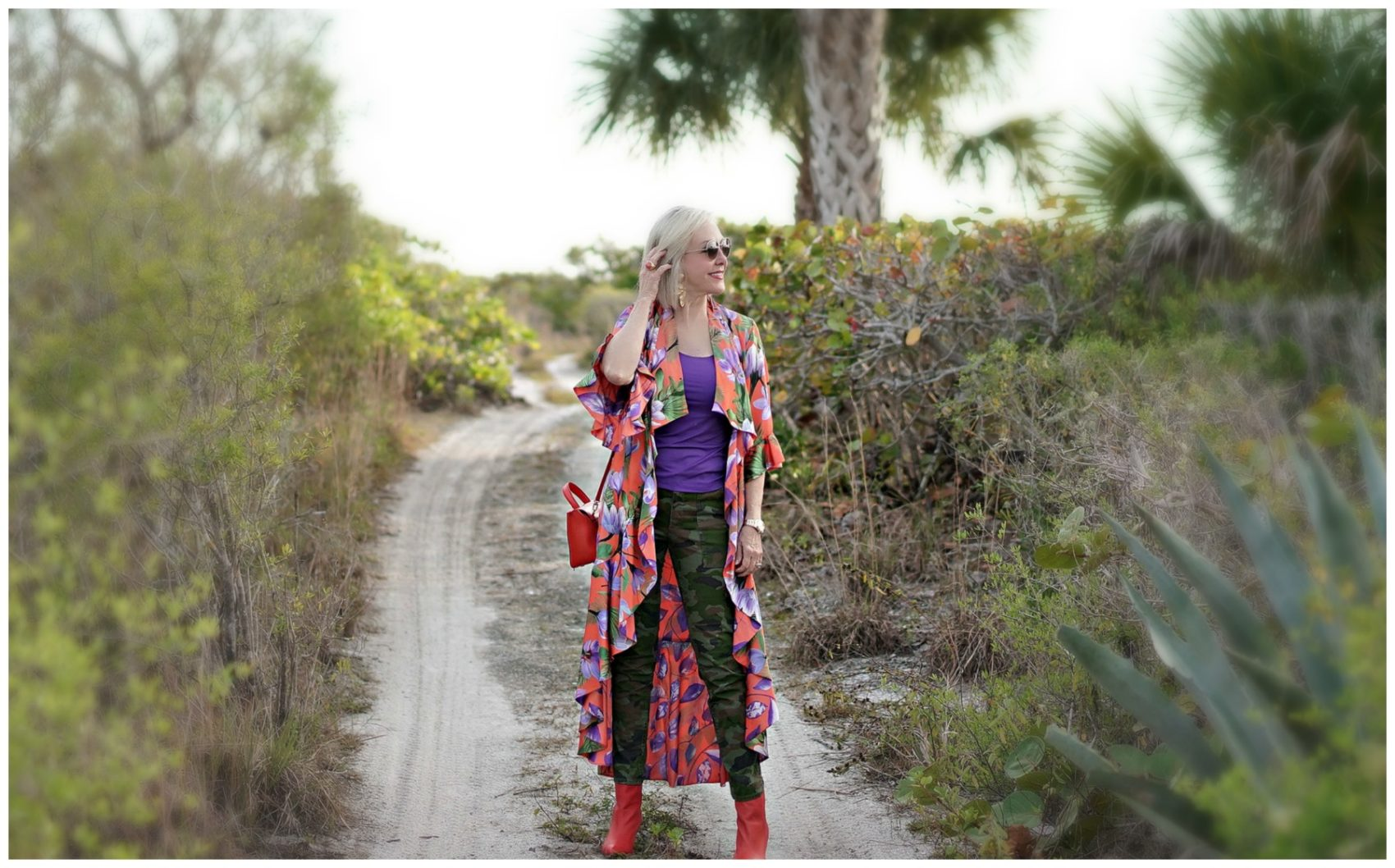 Sheree in alice + olivia kimono walking down a tropical path