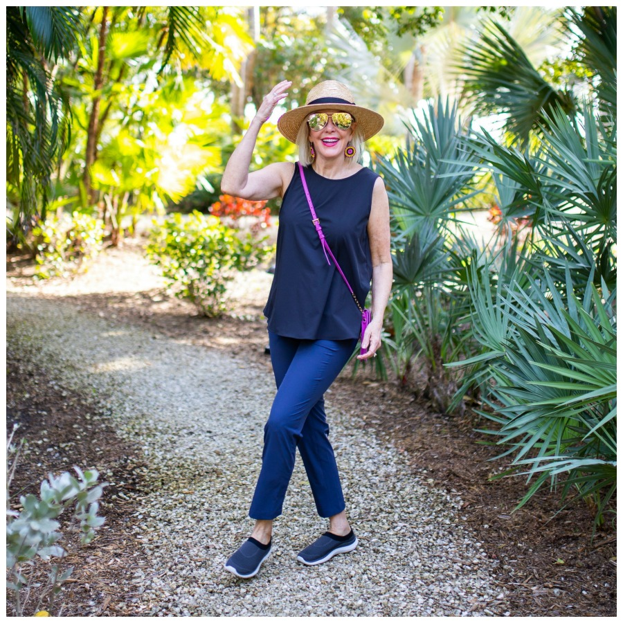 Sheree of the SheShe Show talking a walk wearing navy pants and tank and sneakers
