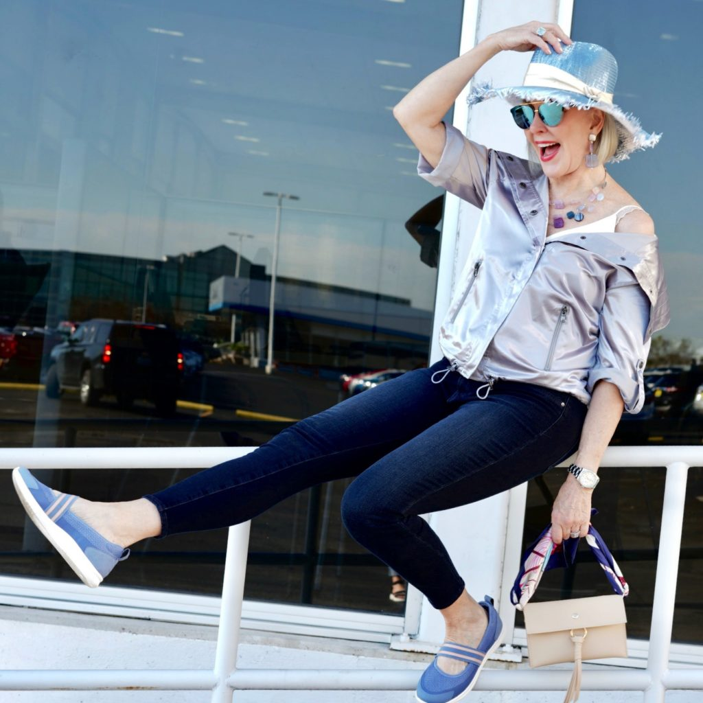 sheree frede wearing silver jacket, blue hat, jeans and easy spirit shoes