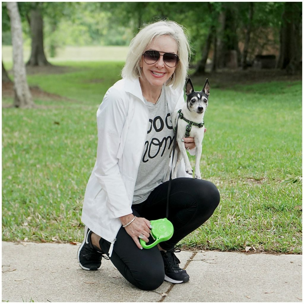 Sheree Frede of the SheShe Show outdoors exercising with her dog.