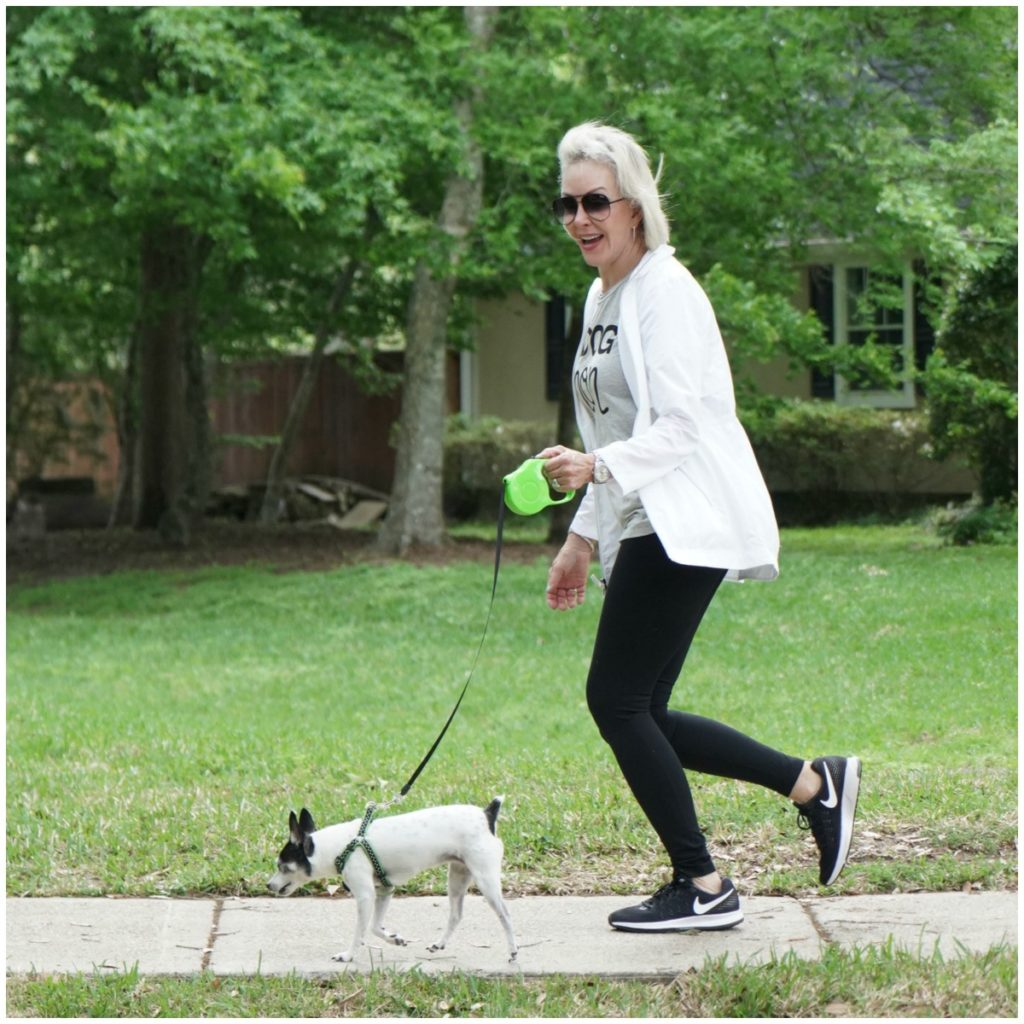 Sheree Frede of the SheShe Show running outside with her dog