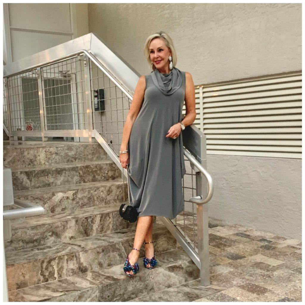 Sheree Frede going up stairs wearing a grey bubble dress