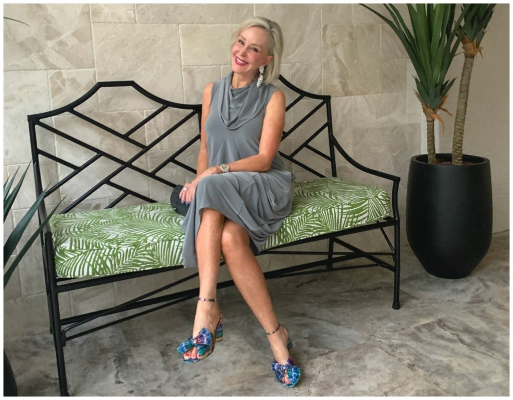 Sheree Frede sitting on a bench wearing a grey bubble dress