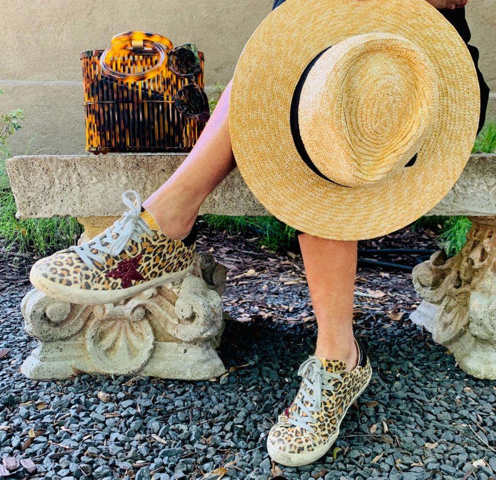 Golden Goose Sneakers, Sun hat and Cult Gaia handbag