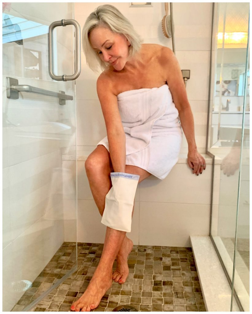 Sheree Frede of the SheShe Show in shower loofing legs with mit