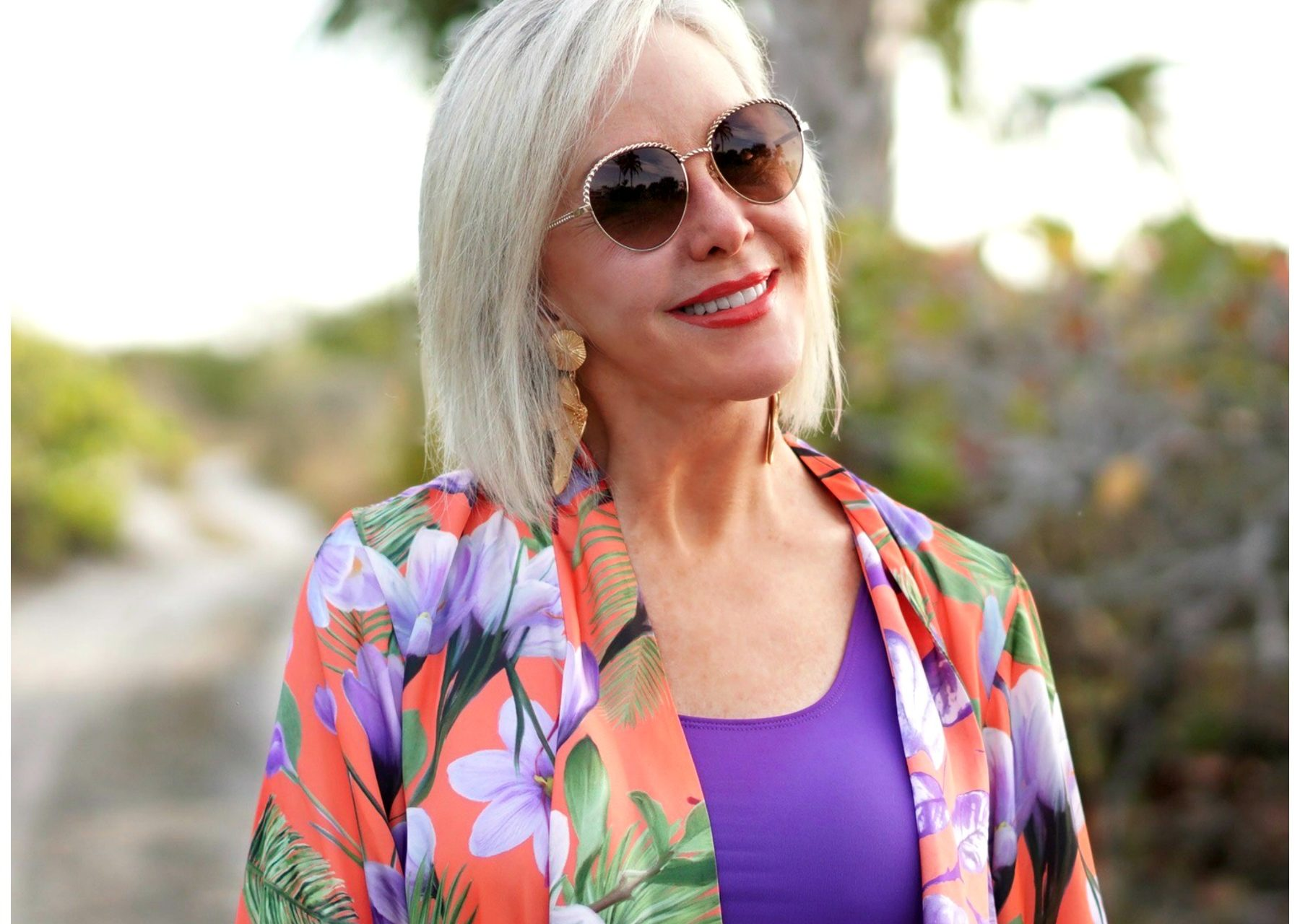 Sheree Frede of the SheShe Show wearing sunglasses and floral top
