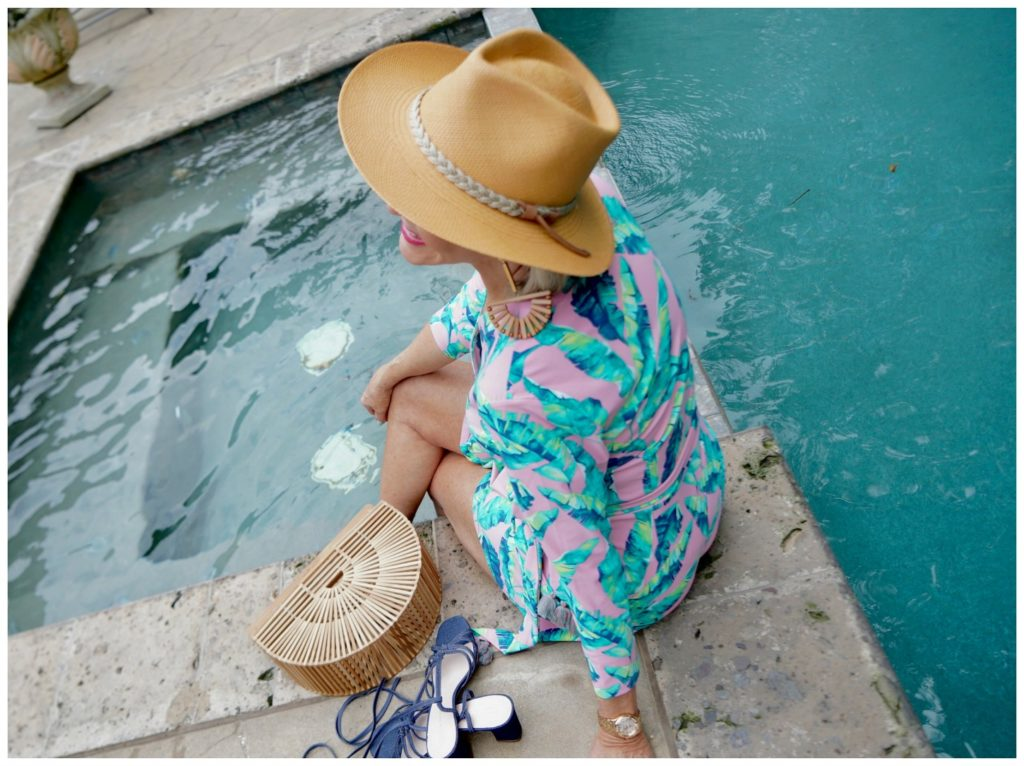 Sheree Frede of the SheShe Show wearing a tan hat by the pool