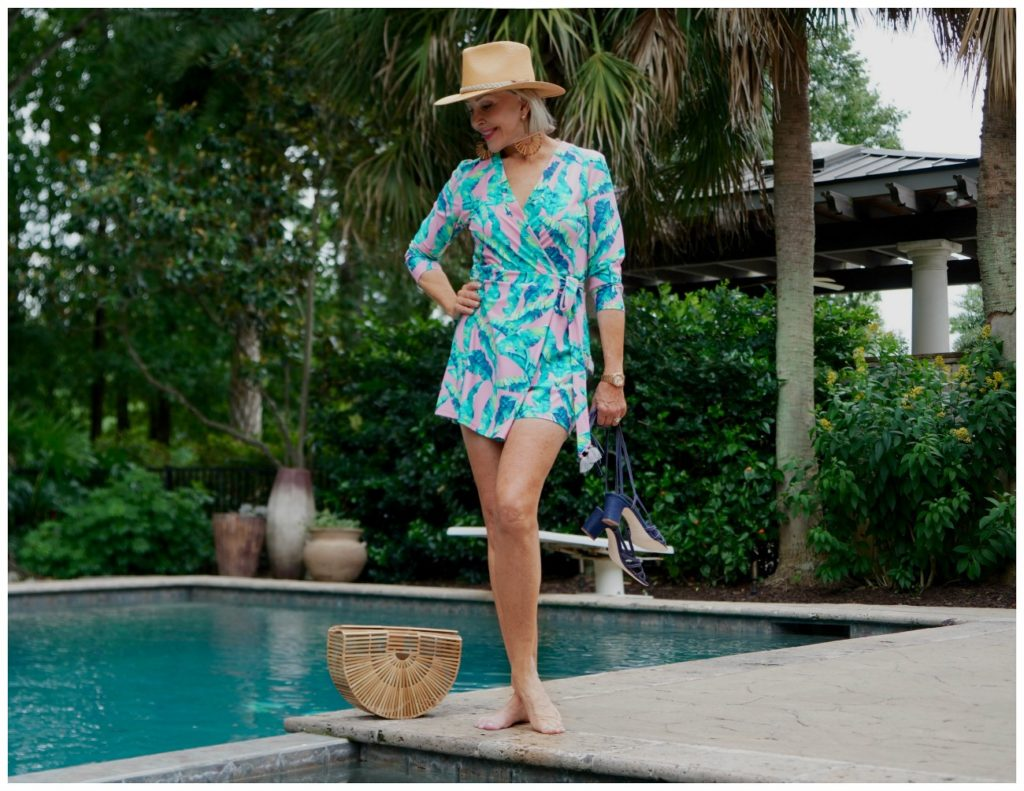 Sheree Frede by swimming pool wearing a turquoise print romper