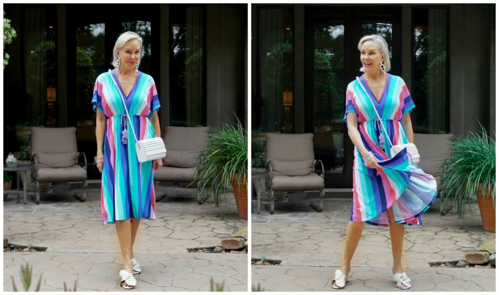 Sheree Frede twirling in a mid lenght multi colored stripe dress