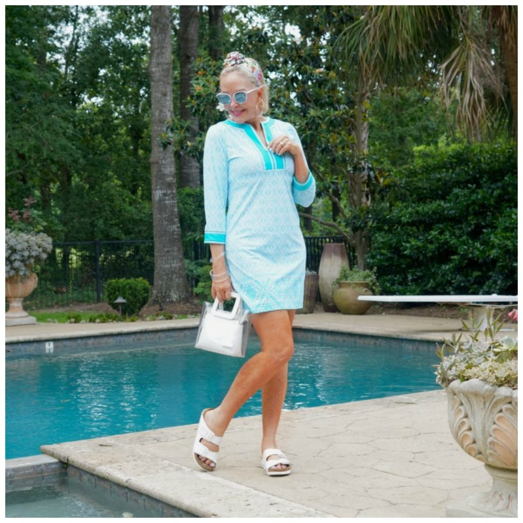 Sheree Frede by swimming pool wearing a turquoise print dress