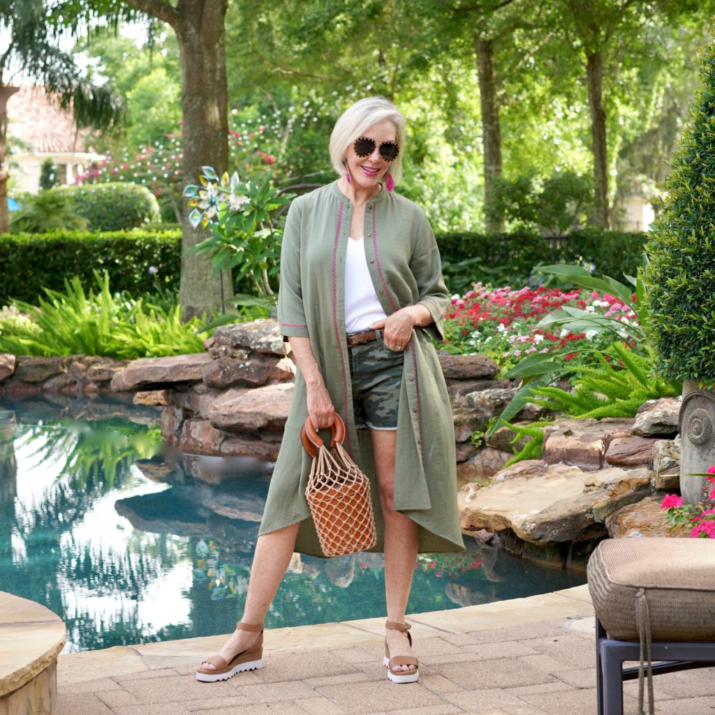 Sheree frede wearing camo shorts and olive colored duster