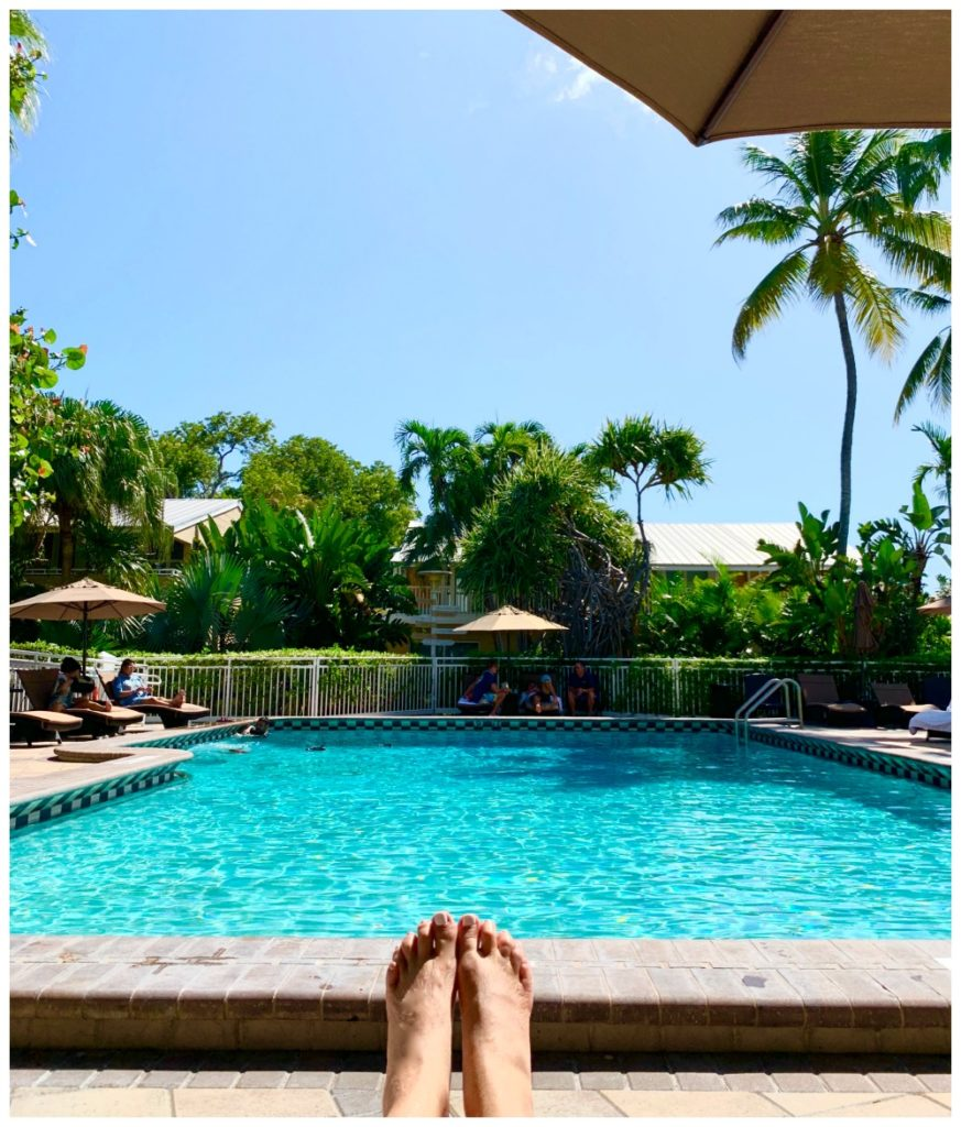 SheShe Show's feet with swimming pool in background