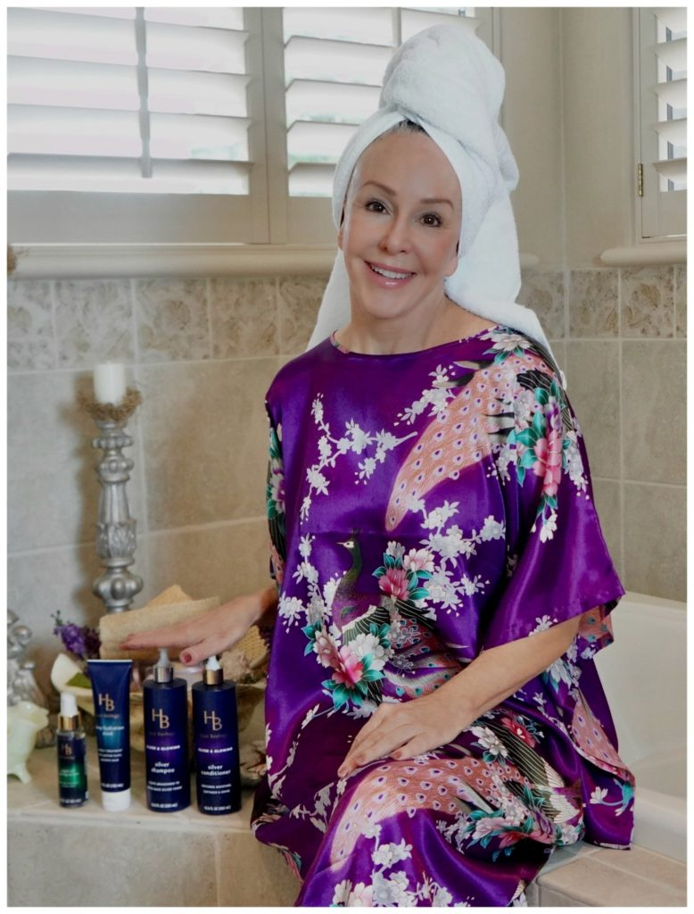 Sheree Frede with the SheShe SHow showing Hair Biology products wearing a purple kimono