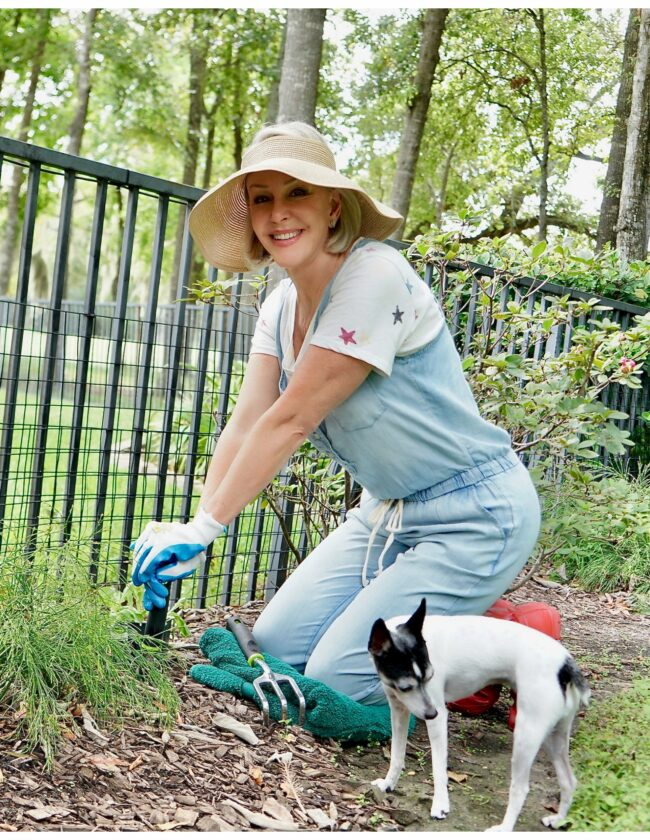 Sheree Frede of the SheShe Show sitting on knees planting her garden
