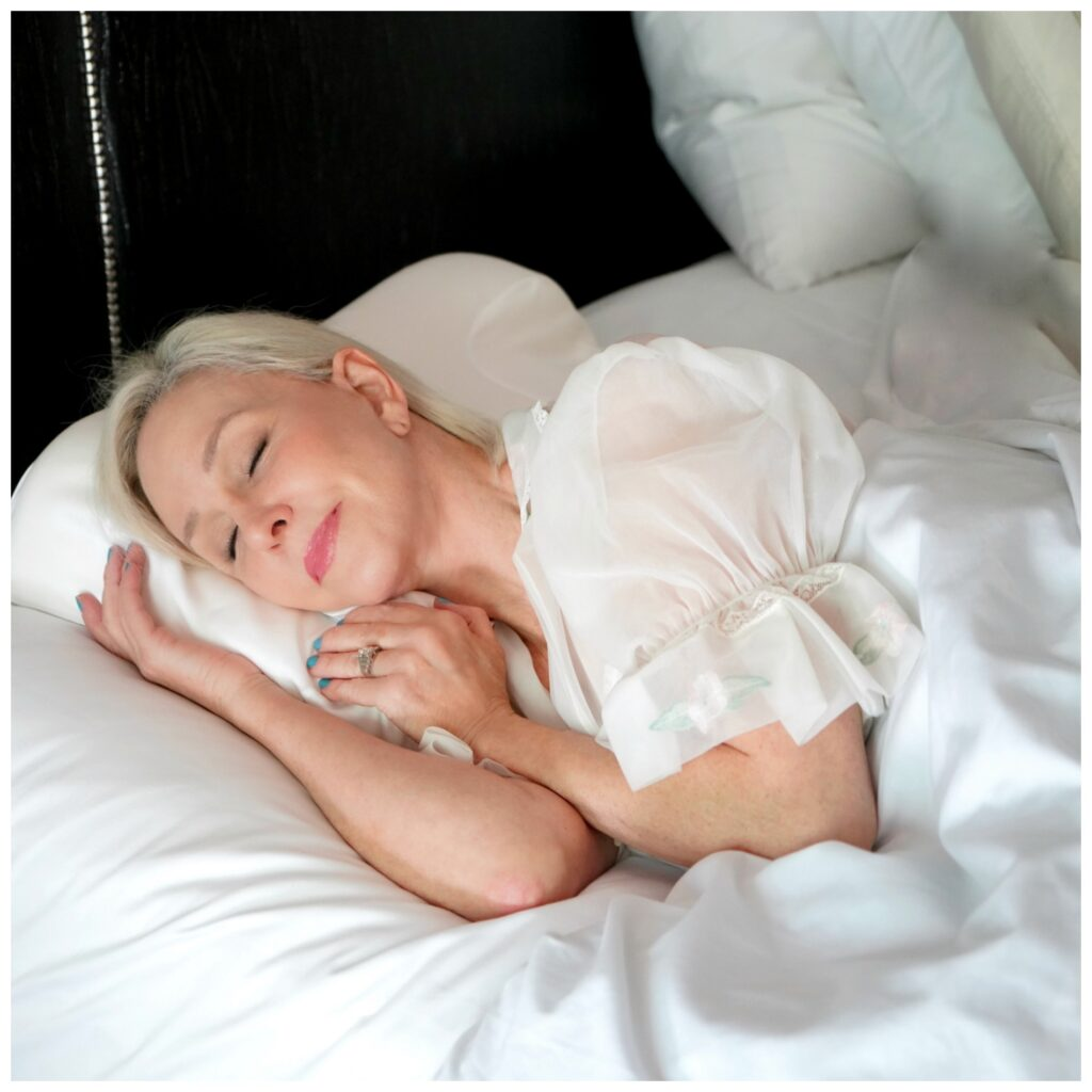 Sheree Frede of the SheShe Show sleeping in a bed
