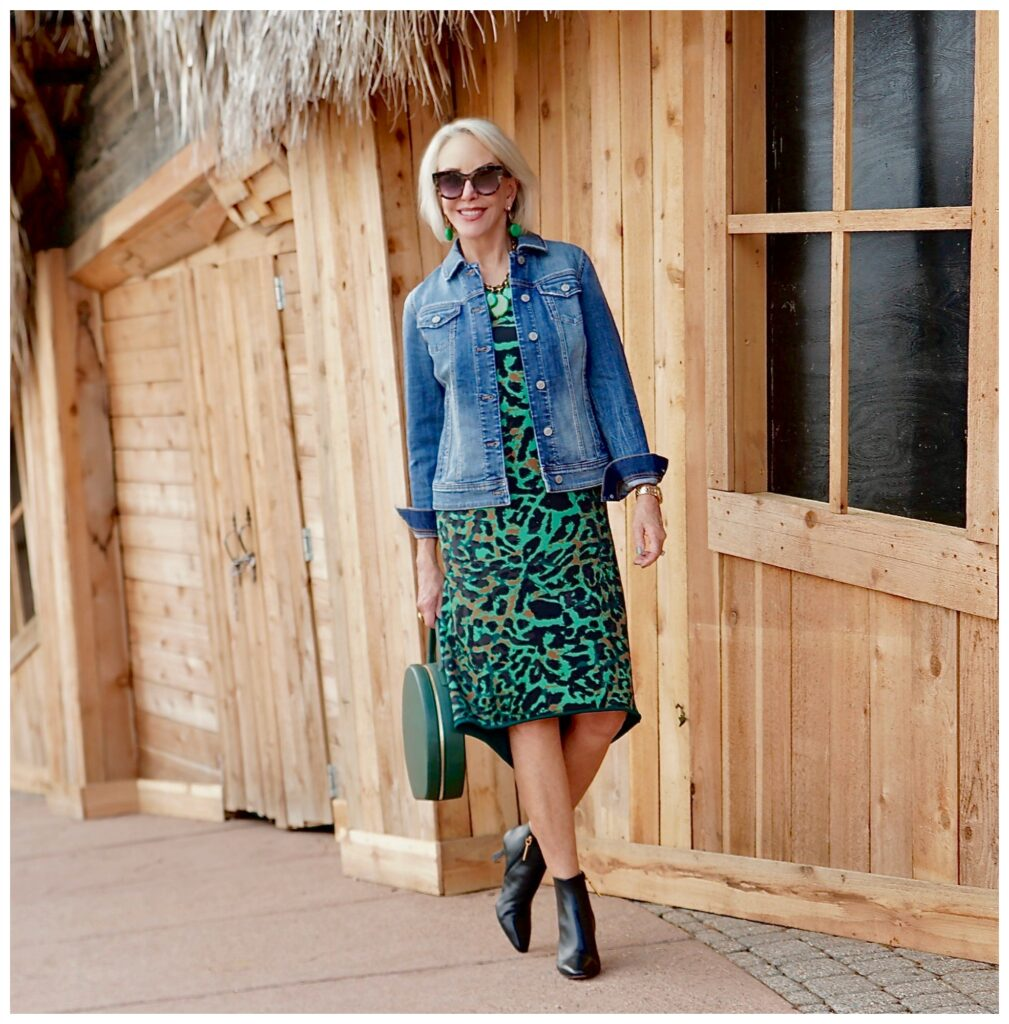 Sheree Frede of the SheSheShow wearing a green leopard dress with denim jacket
