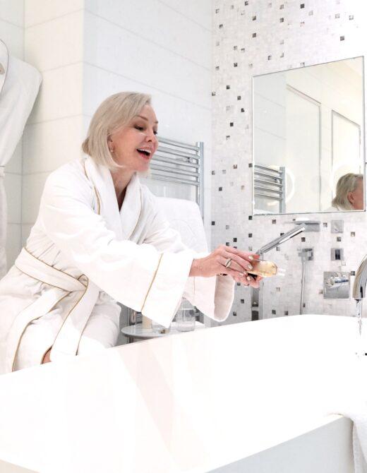sheree frede pouring bubble bath into bathtub