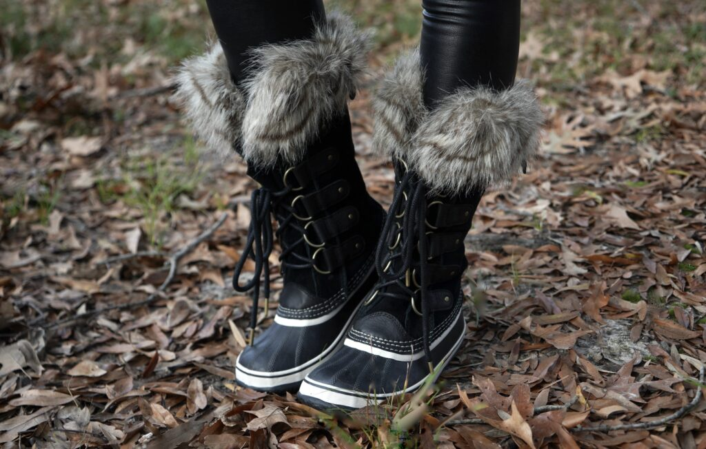 A photo of black Sorel boots with fur