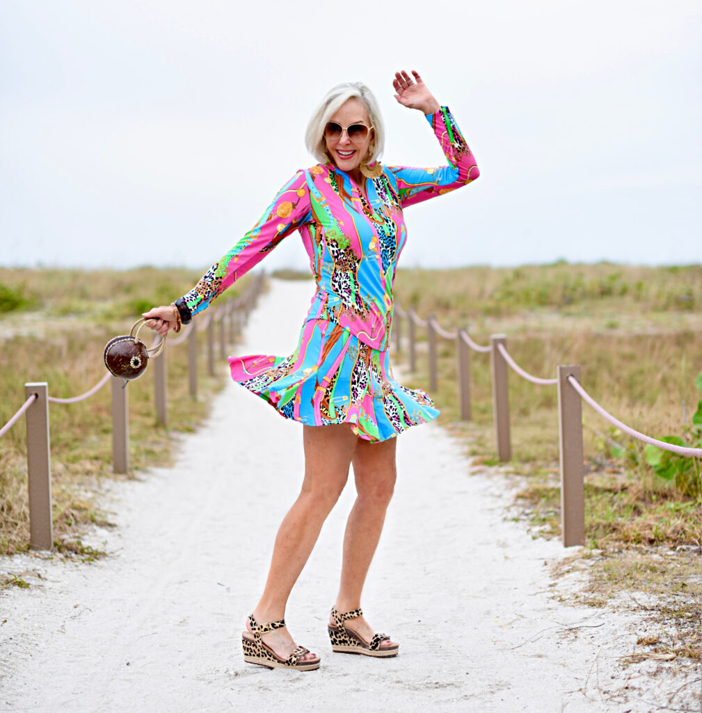 Sheree Frede of the SheSheShow multi-colored spf longsleeve top and skirt, big straw hat, coconut bag, leopard print sandals