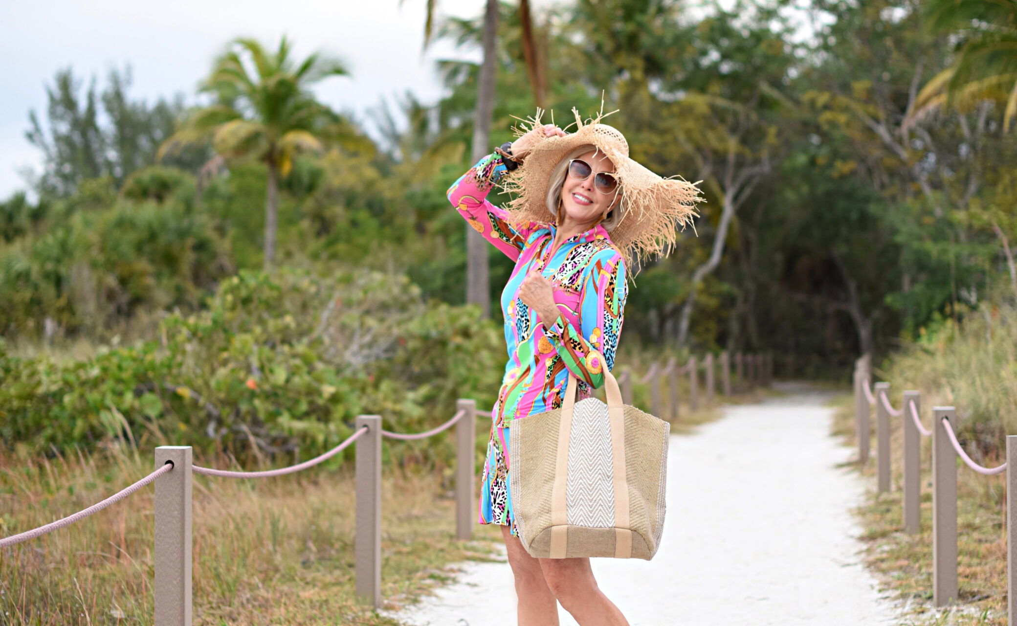 Sheree Frede of the SheSheShow multi-colored spf longsleeve top and skirt, big straw hat, straw tote, beach