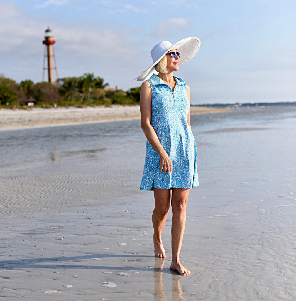 Sheree Frede of the SheSheShow light blue sleeveless dress large white hat