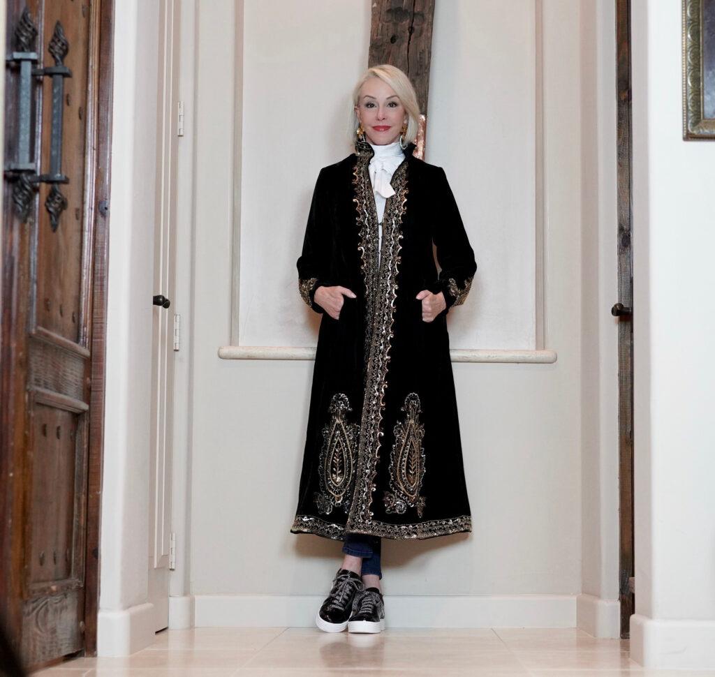 Sheree Frede of the SheSheShow black velvet duster, bow blouse, black patent sneakers