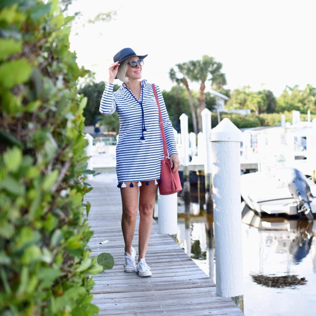 Sheree Frede of the SheShe Show wearing Cabana Life UPF clothing, knee length stripe dress