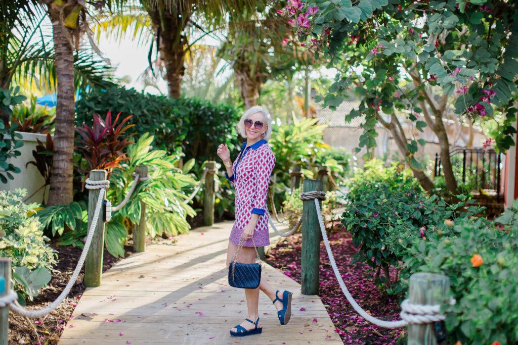 Sheree Frede of the SheShe Show wearing Cabana Life UPF clothing, knee length dress