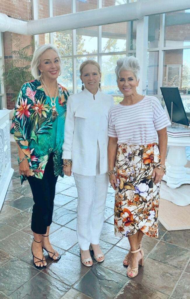 Sheree Frede of the SheShe Show standing with Chico's CEO Molly and Shauna