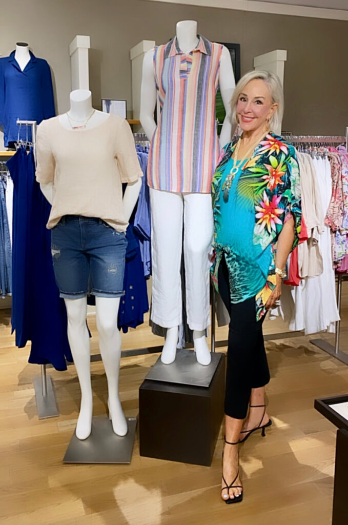 Sheree Frede of the SheShe Show standing by a mannequin