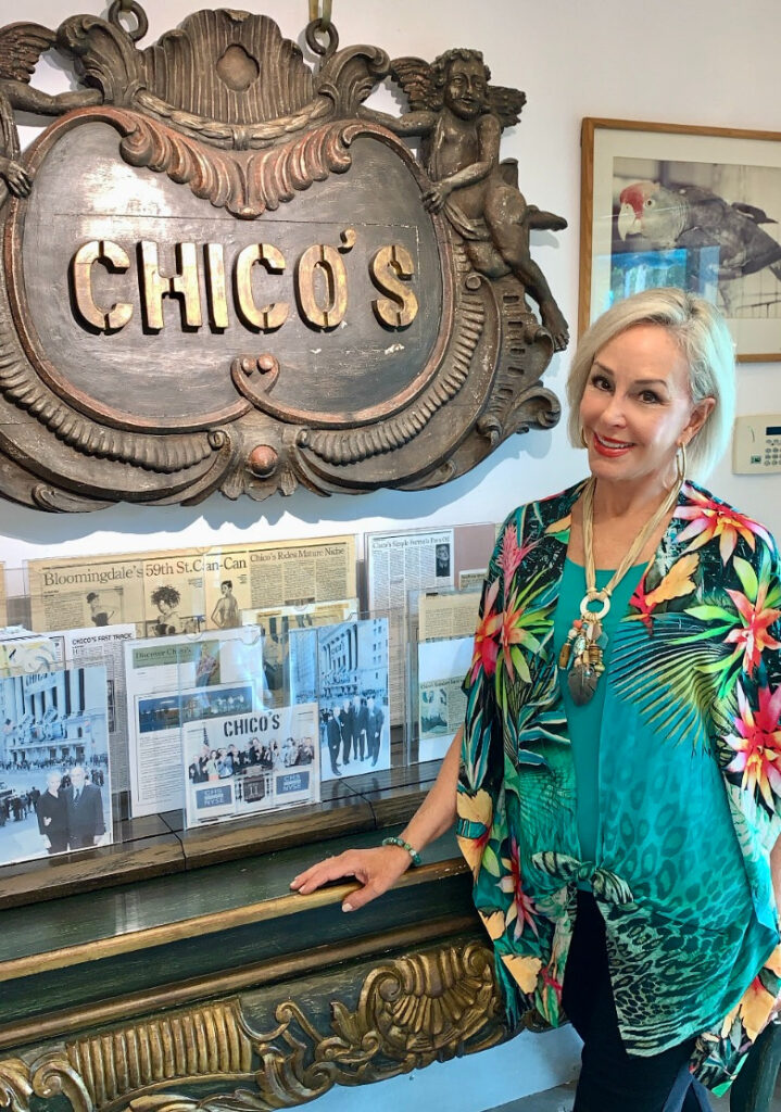 Sheree Frede of the SheShe Show standing in front of Chico's sign