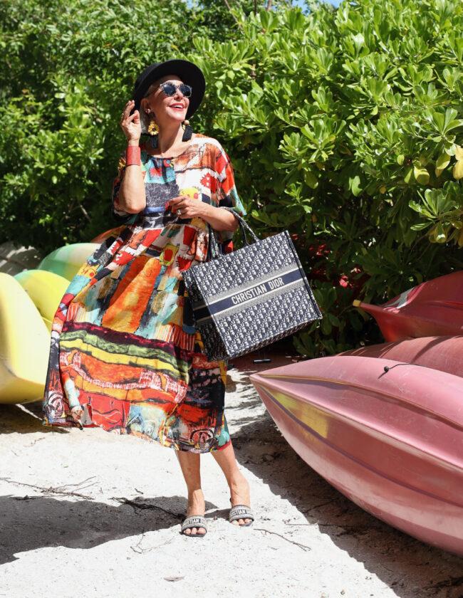Sheree Frede holding a christian dior handbag