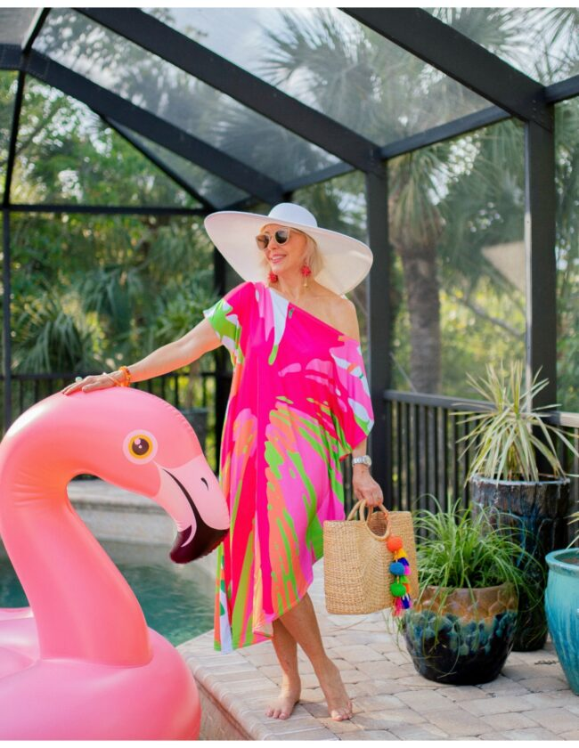 Sheree frede standing by Flo the flamingo pool float