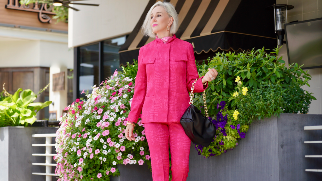 Sheree Frede of the SheShe Show wearing a hot pink pant suit