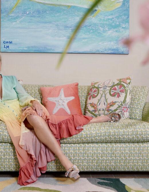 Sheree Frede of the SheShe Show sitting wearing a pastel rainbow chiffon maxi dress