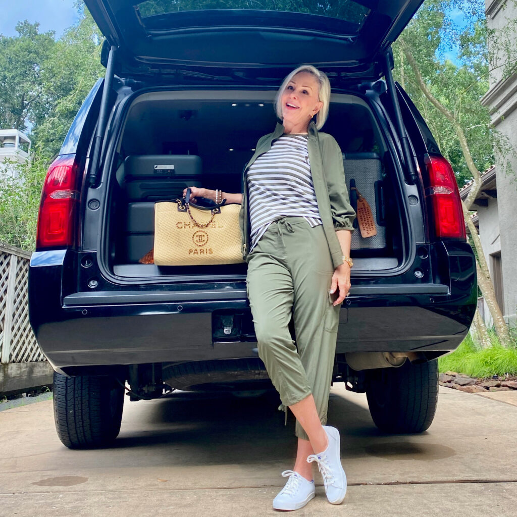 Sheree Frede of the SheShe Show standing behind a Tahoe with bags