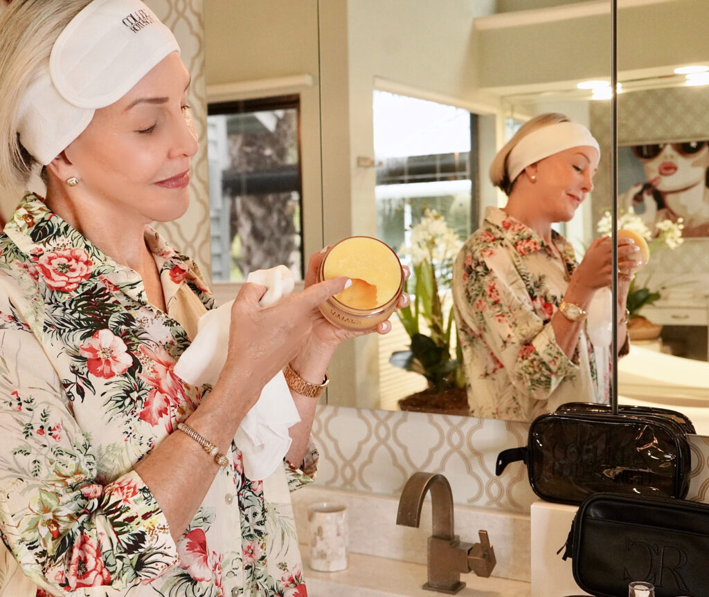 Sheree Frede of the SheShe Show in the bathroom cleaning her face with Colleen Rothschild products