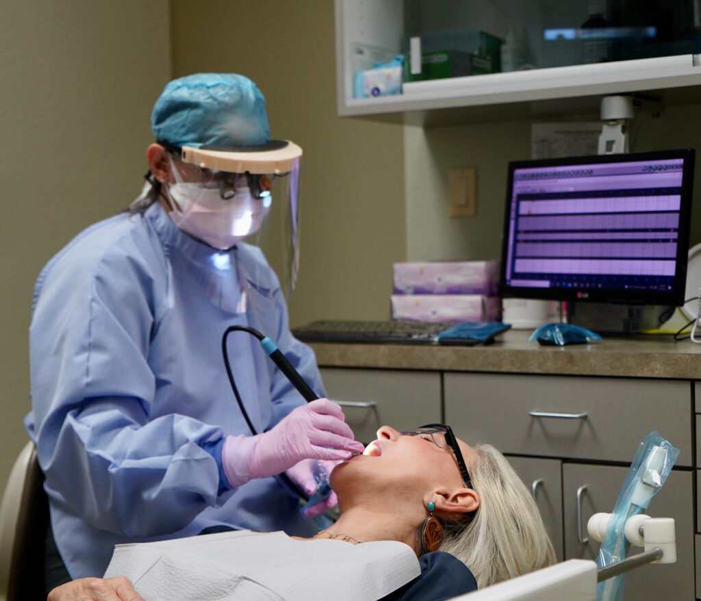 Sheree Frede of the SheShe Show in dental chair getting her teeth cleaned