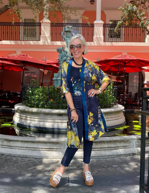 Sheree Frede in Chico's Floral ruana wrap and navy Brigette pant