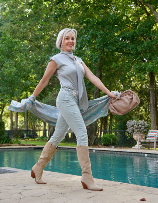 Sheree Frede of the SheShe Show wearing an icy blue jeans and silky top with suede western boots