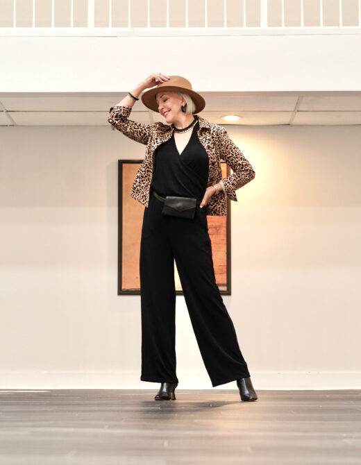 Sheree Frede of the SheShe Show wearing a Chico's black jumpsuit and leopard print jacket