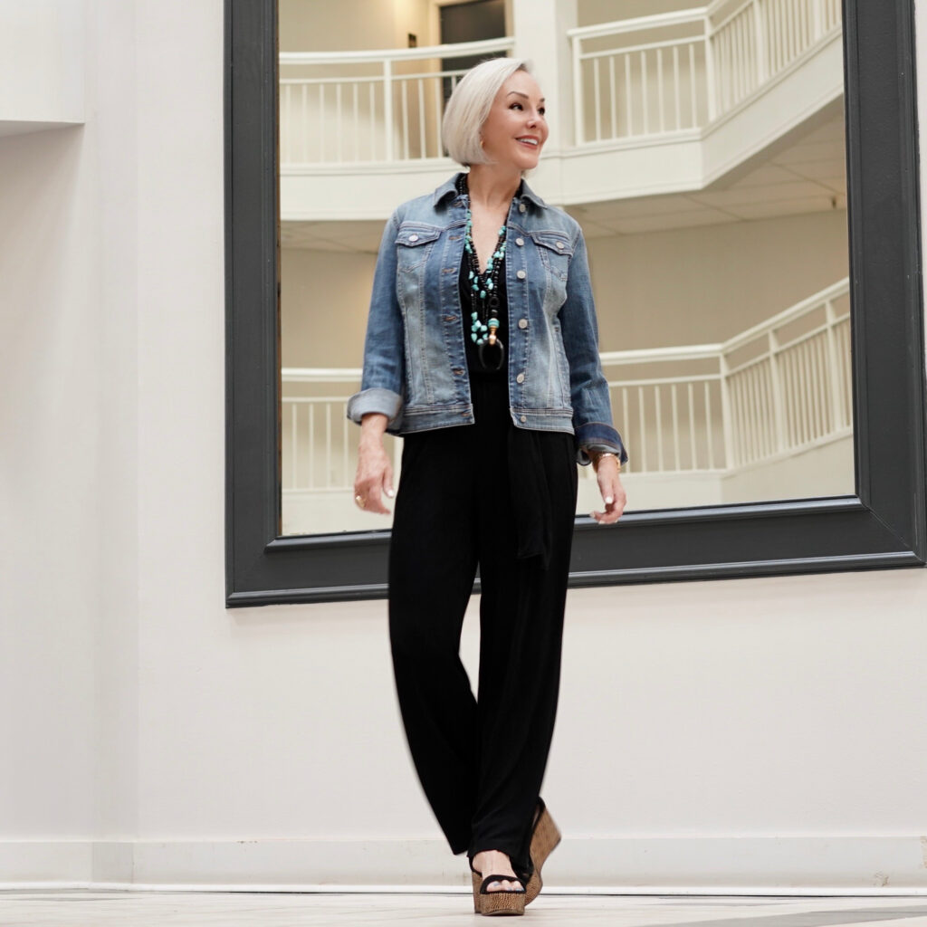 Sheree Frede of the SheShe Show wearing a Chico's black jumpsuit and denim jacket